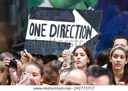 NEW YORK-AUG 23: Fans hold signs for One Direction at NBC's 'Today Show' at Rockefeller Plaza on  August 23, 2013 in New York City. - stock photo