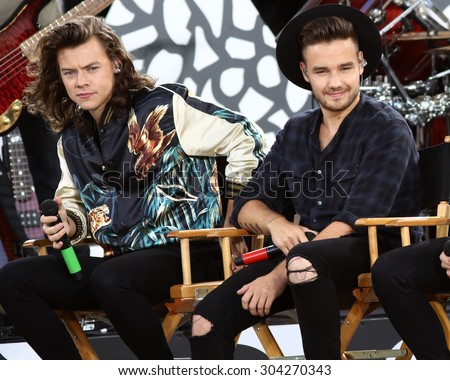 NEW YORK - AUG 4: Harry Styles and Liam Payne of One Direction perform on 'Good Morning America' in Central Park on August 4, 2015 in New York City. - stock photo