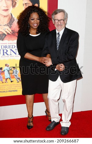 "NEW YORK-AUG 4: Producers Oprah Winfrey (L) and Steven Spielberg attend ""The Hundred-Foot Journey"" premiere at the Ziegfeld Theatre on August 4, 2014 in New York City. - stock photo"