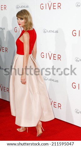 """NEW YORK-AUG 11: Singer Taylor Swift attends the premiere of """"The Giver"""" at the Ziegfeld Theatre on August 11, 2014 in New York City. - stock photo"""