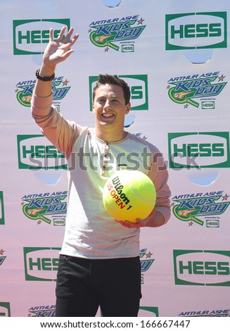 NEW YORK - AUGUST 24   American actor, producer, and Nickelodeon game show host Jeff Sutphen attends Arthur Ashe Kids Day 2013 at Billie Jean King National Tennis Center on August 24, 2013 in New York - stock photo