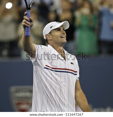 NEW YORK - AUGUST 31: Andy Roddick of USA celebrates victory on 2nd round match against Bernard Tomic of Australia at US Open tennis tournament on August 31, 2012 in Flashing Meadows New York - stock photo