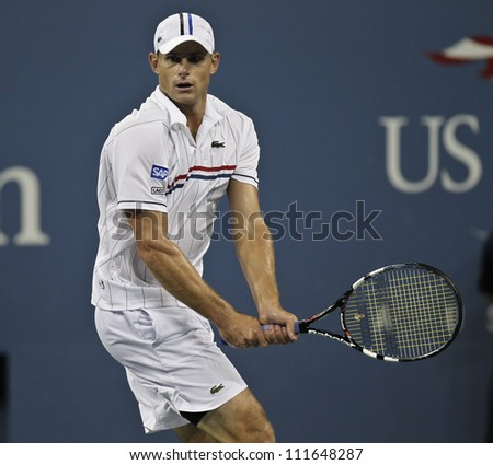 NEW YORK - AUGUST 31: Andy Roddick of USA returns ball during 2nd round match against Bernard Tomic of Australia at US Open tennis tournament on August 31, 2012 in Flashing Meadows New York - stock photo