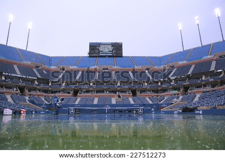 NEW YORK - AUGUST 31: Arthur Ashe Stadium during rain delay at US Open 2014 at Billie Jean King National Tennis Center on August 31, 2014 in Flushing, NY - stock photo