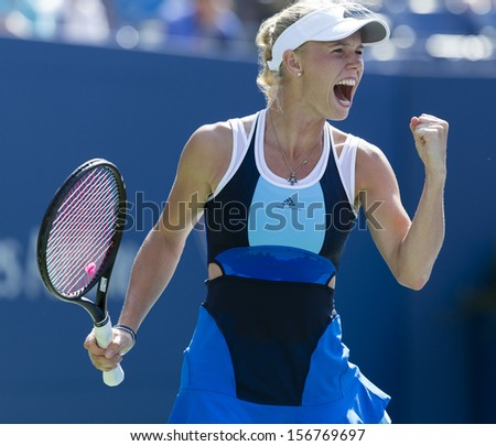 NEW YORK - AUGUST 27: Caroline Wozniacki of Denmark reacts during 1st round match against Ying-Ying Duan of China at 2013 US Open at USTA Billie Jean King Tennis Center on August 27, 2013 in NYC - stock photo
