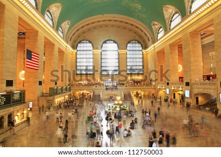 NEW YORK, AUGUST 24: commuters and tourists in the grand central station in August 24, 2012 in New York. It is the largest train station in the world by number of platforms: 44, with 67 tracks - stock photo