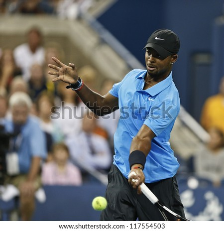 NEW YORK - AUGUST 27: Donald Young of USA returns ball during 1st round match against Roger Federer of Switzerland at US Open tennis tournament on August 27, 2012 in Flushing Meadows New York - stock photo
