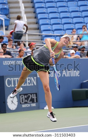 NEW YORK - AUGUST 30, 2015:Five times Grand Slam Champion Maria Sharapova practices for US Open 2015 at National Tennis Center. Few hours later Maria withdraws from US Open with leg injury.  - stock photo