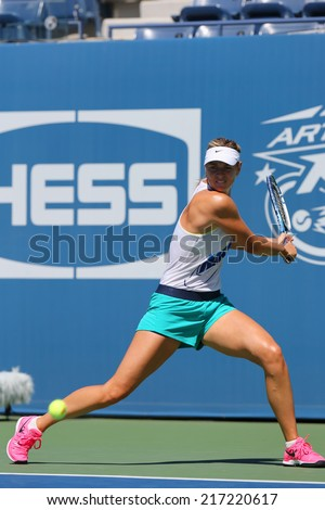 NEW YORK - AUGUST 24: Five times Grand Slam champion Maria Sharapova practices  for US Open 2014 at Arthur Ashe Stadium on August 24, 2014 in New York  - stock photo