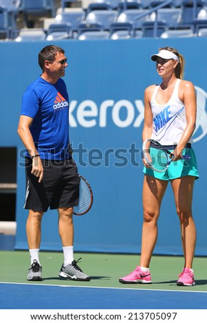 NEW YORK - AUGUST 24: Five times Grand Slam champion Maria Sharapova practices with her coach Sven Groeneveld for US Open 2014 at Arthur Ashe Stadium on August 24, 2014 in New York - stock photo