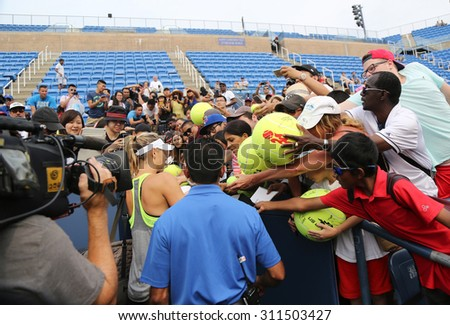 NEW YORK - AUGUST 30, 2015:Five times Grand Slam champion Maria Sharapova signing autographs after practice for US Open 2015. Few hours later Maria withdraws from US Open with leg injury.  - stock photo