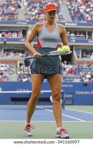 NEW YORK- AUGUST 31, 2014: Five times Grand Slam champion Mariya Sharapova in action during her third round match at US Open 2014 against Caroline Wozniacki at Arthur Ashe stadium in New York - stock photo
