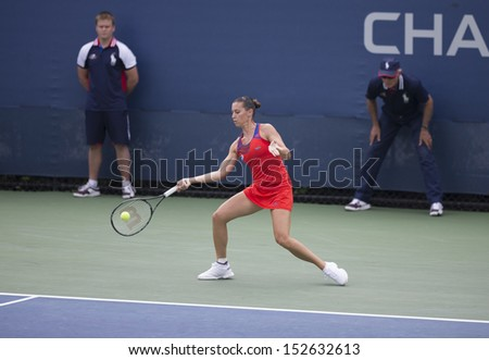 NEW YORK - AUGUST 31: Flavia Pennetta of Italy returns ball during 3rd round match against Svetlana Kuznetsova of Russia at 2013 US Open at USTA Billie Jean King Tennis Center on August 31 2013 in NYC - stock photo
