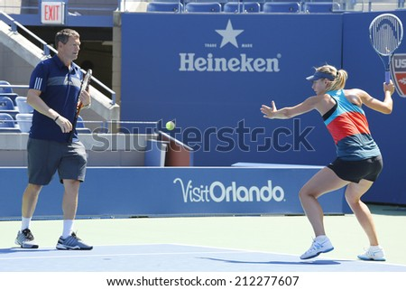 NEW YORK - AUGUST 19: Four times Grand Slam champion Maria Sharapova practices with her coach Sven Groeneveld for US Open 2014 at Arthur Ashe Stadium on August 19, 2014 in New York  - stock photo