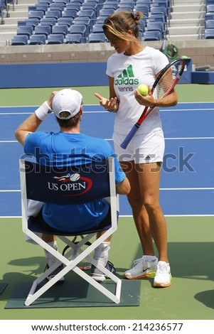 NEW YORK - AUGUST 21: Grand Slam Champion Andy Murray practices with his coach Amelie Mauresmo for US Open 2014 at Billie Jean King National Tennis Center on August 21, 2014 in New York  - stock photo