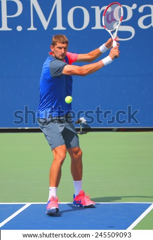 NEW YORK - AUGUST 31, 2014:  Grand Slam champion Max Mirnyi from Belarus during second round mixed double match at US Open 2014 at Billie Jean King National Tennis Center  - stock photo