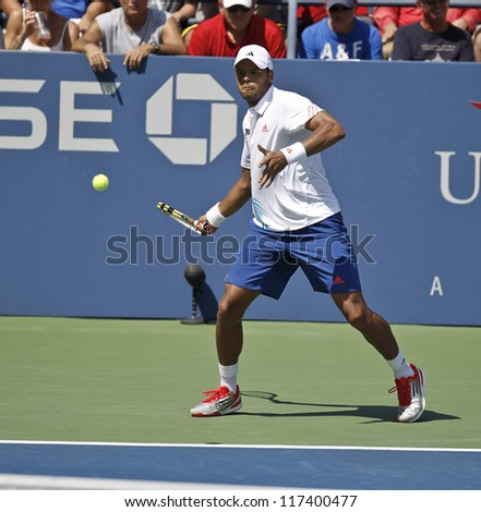 NEW YORK - AUGUST 28: Jo-Wilfried Tsonga of France returns ball during 1st round match against Karol Beck of Slovakia at US Open tennis tournament on August 28, 2012 in Flushing Meadows New York - stock photo