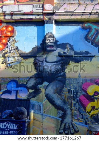 "NEW YORK - AUGUST 15: King Kong at 5 Pointz Aerosol Arts Center, Inc. on AUGUST 15, 2013 in New York. 5 Pointz, considered the ""Graffiti Mecca"", is scheduled to be torn down for a residential project. - stock photo"