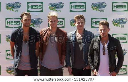 NEW YORK - AUGUST 24: (L-R) Andy Brown, Ryan Fletcher, Joel Peat, Adam Pitts of Lawson attend the 2013 Arthur Ashe Kids Day at USTA Billie Jean King Tennis Center on August 24, 2013 in New York City - stock photo
