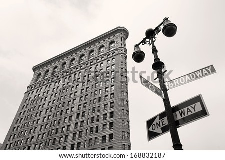 NEW YORK - AUGUST 30: Low angle view of the Flatiron building from the corner of Broadway and E23rd St. on a cloudy day, on August 30, 2013. - stock photo