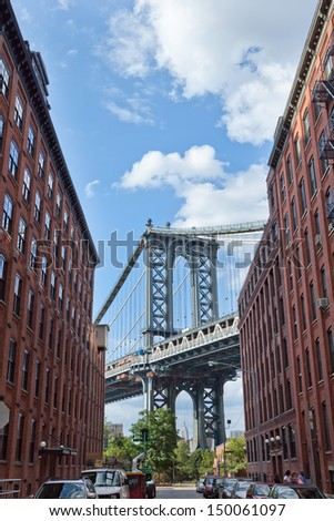 NEW YORK - AUGUST 13: Manhattan Bridge on August 13, 2013 in New York. The Manhattan Bridge is a suspension bridge that crosses the East River, connecting Lower Manhattan with Brooklyn. - stock photo