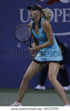 NEW YORK - AUGUST 31: Maria Sharapova serves during first round match against Jarmila Groth of Australia at US Open tennis tournament on August 30, 2010, New York. - stock photo