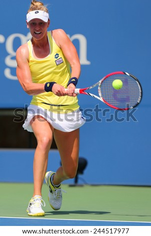 NEW YORK - AUGUST 26, 2014: Professional tennis player Alison Riske from USA during US Open 2014 match against Grand Slam Champion Ana Ivanovic at Billie Jean King National Tennis Center in New York  - stock photo