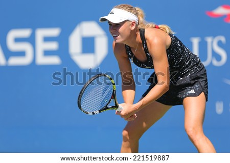 NEW YORK - AUGUST 24: Professional tennis player Caroline Wozniacki practices for US Open 2014 at Billie Jean King National Tennis Center on August 24, 2014 in New York - stock photo