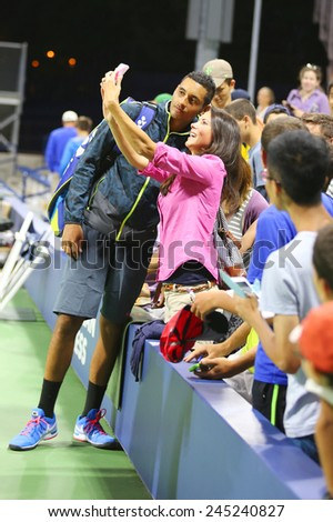 NEW YORK - AUGUST 28, 2014: Professional tennis player Nick Kyrgios from Australia taking selfie with fan after win at US Open 2014 match at Billie Jean King National Tennis Center - stock photo