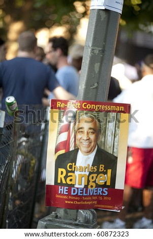 NEW YORK - AUGUST 28: Residents pass by a Charlie Rangel poster in New York on August 28, 2010.  Congressman Rangel is under investigation for ethics violations. - stock photo