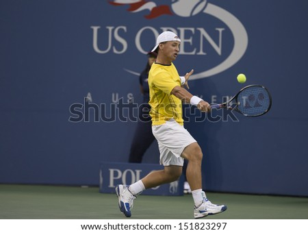 NEW YORK - AUGUST 27: Ricardas Berankis of Lithuania returns ball during 1st round match against Novak Djokovic of Serbia at 2013 US Open at USTA Billie Jean King Tennis Center on Aug 27, 2013 in NYC - stock photo
