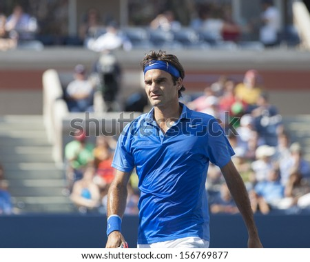 NEW YORK - AUGUST 27: Roger Federer of Switzerland reacts during 1st round match against Grega Zemlja of Slovakia at 2013 US Open at USTA Billie Jean King Tennis Center on August 27, 2013 in NYC - stock photo