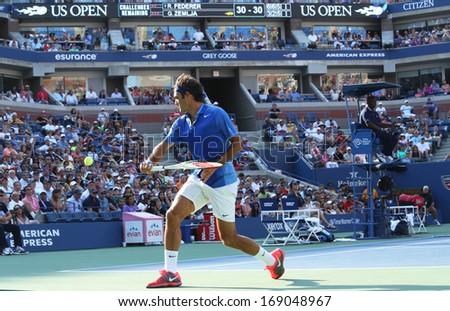 NEW YORK- AUGUST 27  Seventeen times Grand Slam champion Roger Federer during match at US Open 2013 against Grega Zemlja at Billie Jean King National Tennis Center on August 27, 2013 in New York - stock photo