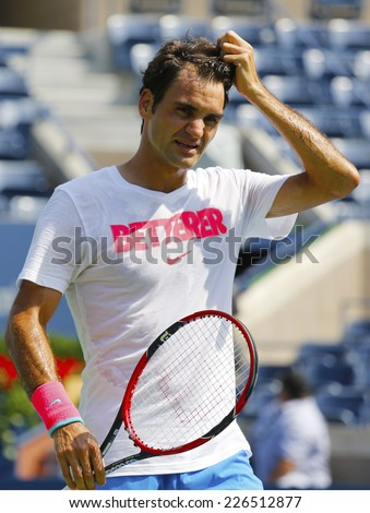 NEW YORK - AUGUST 21: Seventeen times Grand Slam champion Roger Federer practices for US Open 2014 at Billie Jean King National Tennis Center on August 21, 2014 in New York - stock photo