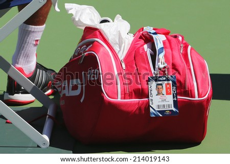 NEW YORK - AUGUST 24 Six times Grand Slam champion Novak Djokovic customized Head tennis bag at US Open 2014 at Billie Jean King National Tennis Center on August 24, 2014 in New York - stock photo