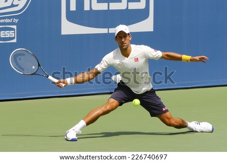 NEW YORK - AUGUST 21: Six times Grand Slam champion Novak Djokovic practices for US Open 2014 at Billie Jean King National Tennis Center on August 21, 2014 in New York  - stock photo