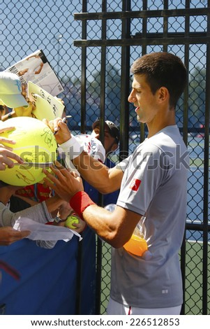 NEW YORK - AUGUST 28 Six times Grand Slam champion Novak Djokovic signing autographs after practice for US Open 2014 at Billie Jean King National Tennis Center on August 28, 2014 in New York - stock photo