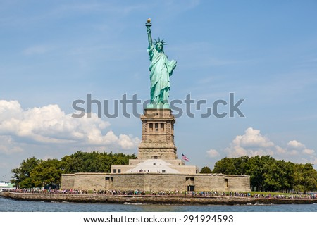 NEW YORK - AUGUST 11: Statue of Liberty on Liberty Island in New York Harbor, in Manhattan, NY on August 11, 2014. Statue of Liberty is one of the most recognizable landmarks of New York City. - stock photo