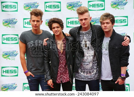 NEW YORK - AUGUST 23, 2014: The Vamps British pop band participates at Arthur Ashe Kids Day 2014 at Billie Jean King National Tennis Center in New York - stock photo