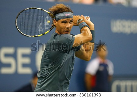 NEW YORK - AUGUST 29, 2013: Twelve times Grand Slam champion Rafael Nadal  of Spain in action during his second round match at US Open 2013 at Arthur Ashe Stadium in New York - stock photo