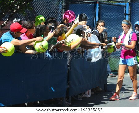 NEW YORK - AUGUST 24 Two times Grand Slam champion Victoria Azarenka signing autographs after practice for US Open 2013 at Billie Jean King National Tennis Center on August 24, 2013 in New York  - stock photo