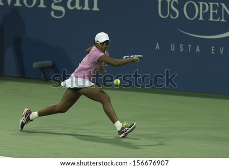 NEW YORK - AUGUST 29: Victoria Duval of USA returns ball during 2nd round match against Daniela Hantuchova of Slovakia at 2013 US Open at USTA Tennis Center on August 29, 2013 in New York - stock photo