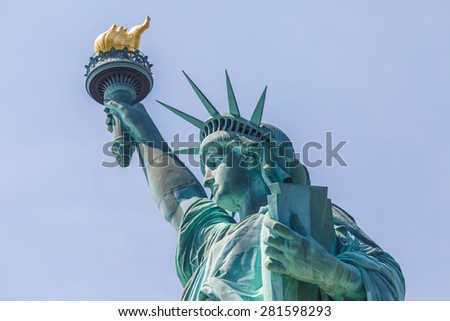 NEW YORK - AUGUST 2014: View on Statue of Liberty on August 11, 2014 in Manhattan, NY. Statue of Liberty is one of the most recognizable landmark of New York City. - stock photo