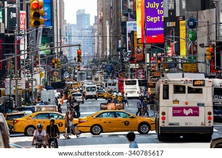 NEW YORK - AUGUST 22: Views of the rush streets of Manhattan at 7th Avenue on August 22, 2015. Its on the intersection of W53 Street near the Times Square.  - stock photo