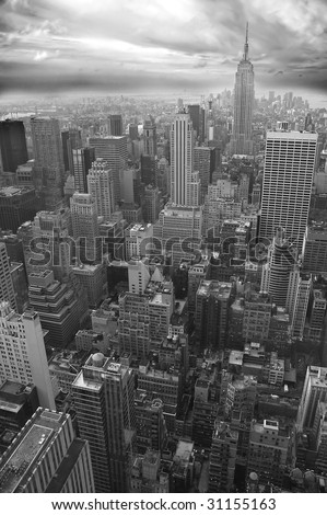 New York black and white vertical photo, Empire State Building visible in distance - stock photo