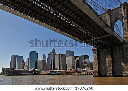 New York Brooklyn Bridge and Manhattan - stock photo