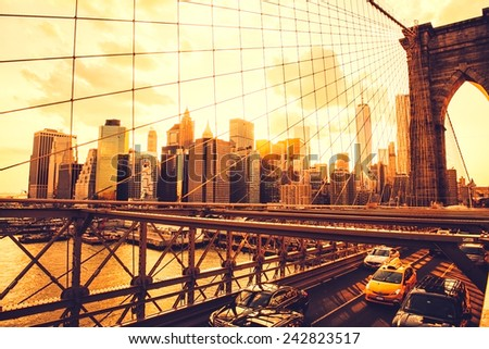 New York,Brooklyn Bridge and Manhattan Skyline at sunset - stock photo