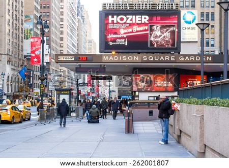 New York, circa dec 2014: People walk in front entrance of madison square garden in manhattan - stock photo