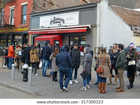 NEW YORK - CIRCA JANUARY 2015. Customers wait outside Julianas Pizzeria in Brooklyn, a re-opening of a pizza restaurant by Patsy and Carol Grimaldi, known as New Yorks pizza family. - stock photo