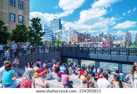 NEW YORK - CIRCA MAY 2013: The High Line Park, New York, circa May 2013. The High Line is a popular linear park built on the elevated train tracks above Tenth Ave in New York City - stock photo